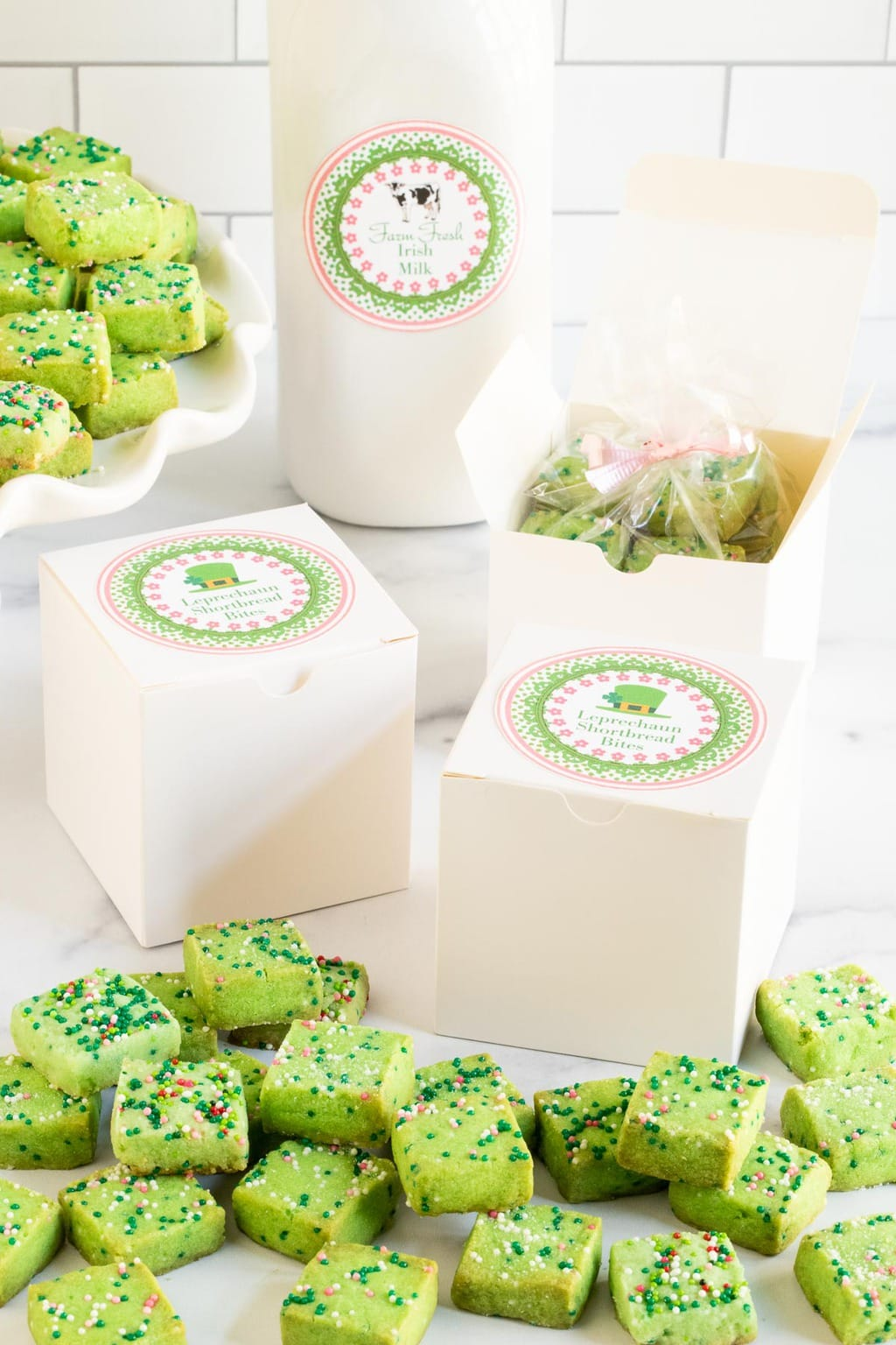 Vertical photo of Leprechaun Shortbread Bites packaged in gift boxes with a custom St. Patrick's Day label on the boxes.