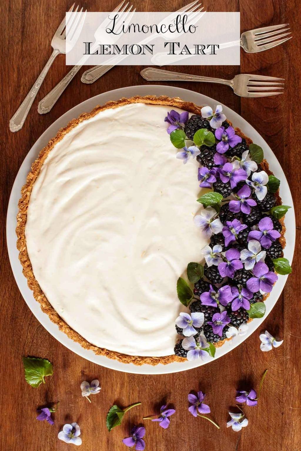 A modern update to an old-fashioned icebox torte, this Limoncello Lemon Tart is melt-in-your-mouth delicious - with a few fabulous gourmet touches! #lemontart, #easylemontart, #limoncellorecipe, #edibleflowers