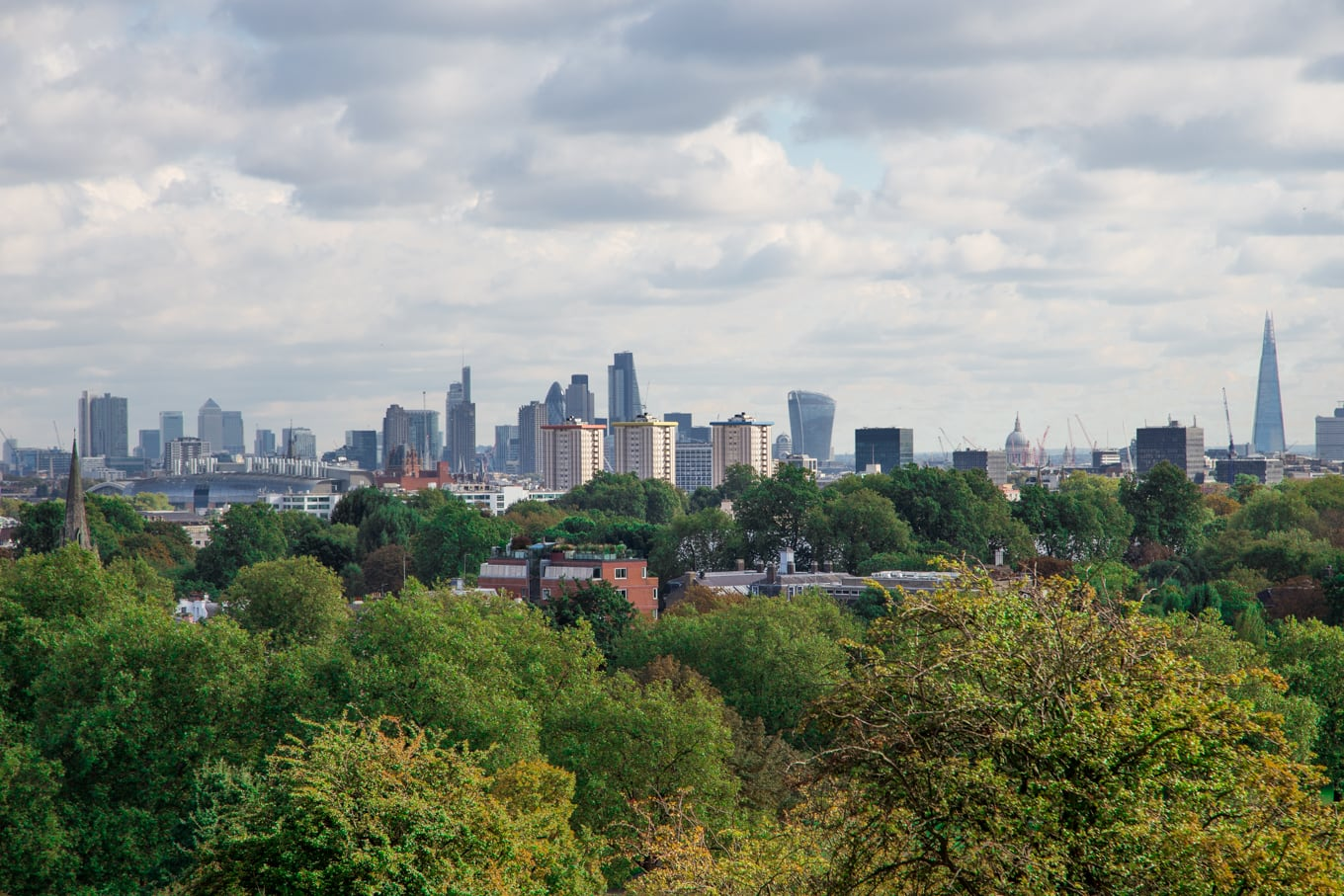 Panoramic photo of the London city skyline from Primrose Hill Park.