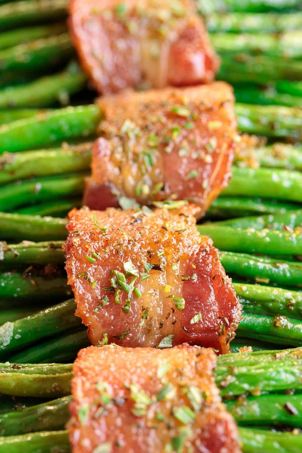 Ultra Closeup photo of Make-Ahead Bacon Wrapped Green Beans.