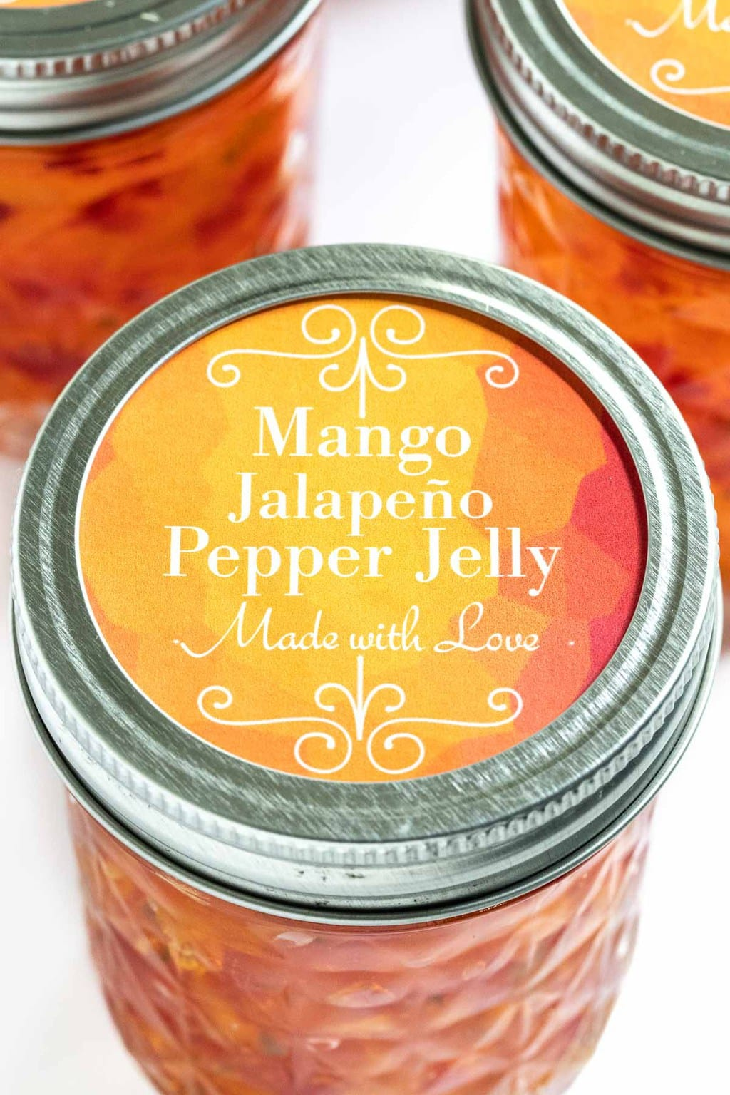 Ultra closeup photo of the cap label on a jar of Mango Jalapeño Pepper Jelly.