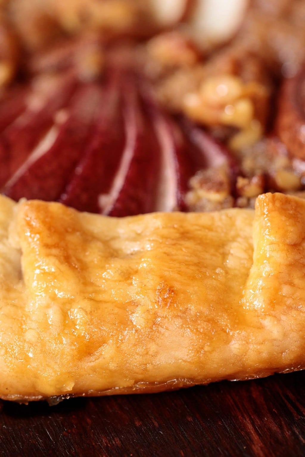 Extreme closeup photo of the crust of a Maple-Glazed Red Pear Galette.