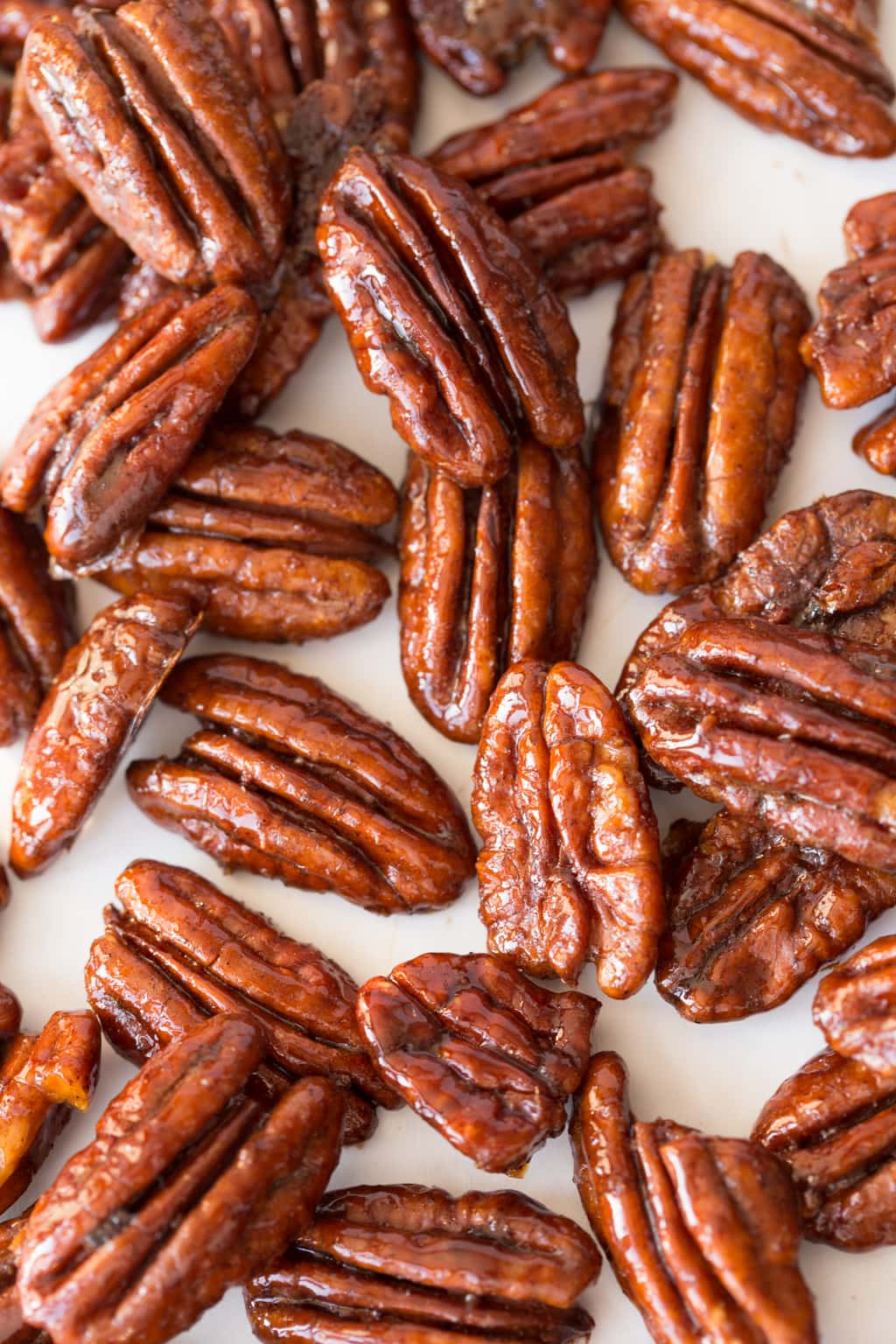 Maple Molasses Glazed Pecans - super easy and crazy delicious, these pecans are fabulous as a snack or cocktail nibble, on salads and dessert and make a wonderful gift.