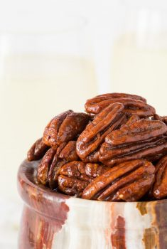 Vertical picture of Maple Molasses Glazed Pecans in a small bowl