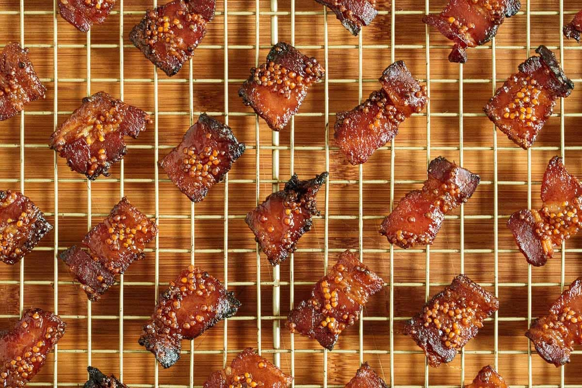 Overhead photo of Maple Mustard Candied Bacon on a cooling rack.
