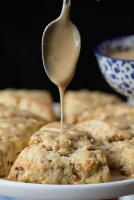 Maple Pecan Scones - a ridiculously easy technique for incredibly delicious, pecan-studded, melt-in-your-mouth scones finished off with a drizzle of sweet, maple-infused glaze.