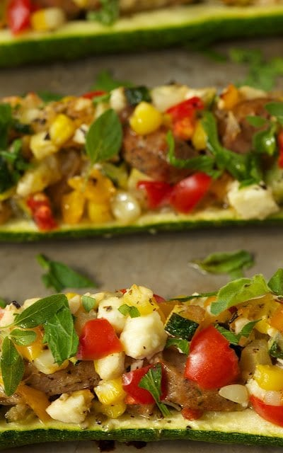 Photo of long slices of Mediterranean Style Stuffed Zucchini horizontally placed in the picture.