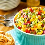Image of Mexican Chopped Salad in a bowl with crisp tortilla strips.