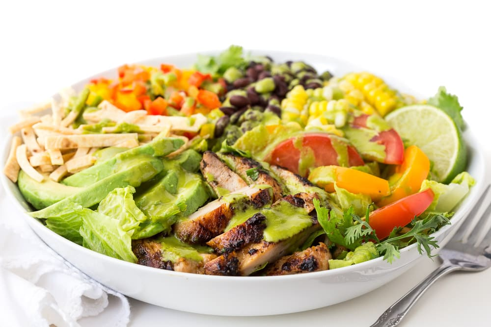 Photo of a Mexican Honey Lime Grilled Chicken Salad in a white serving bowl.