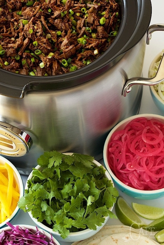 Vertical pictures of Slow Cooker Mexican Shredded Beef in a slow cooker with small bowls of toppings