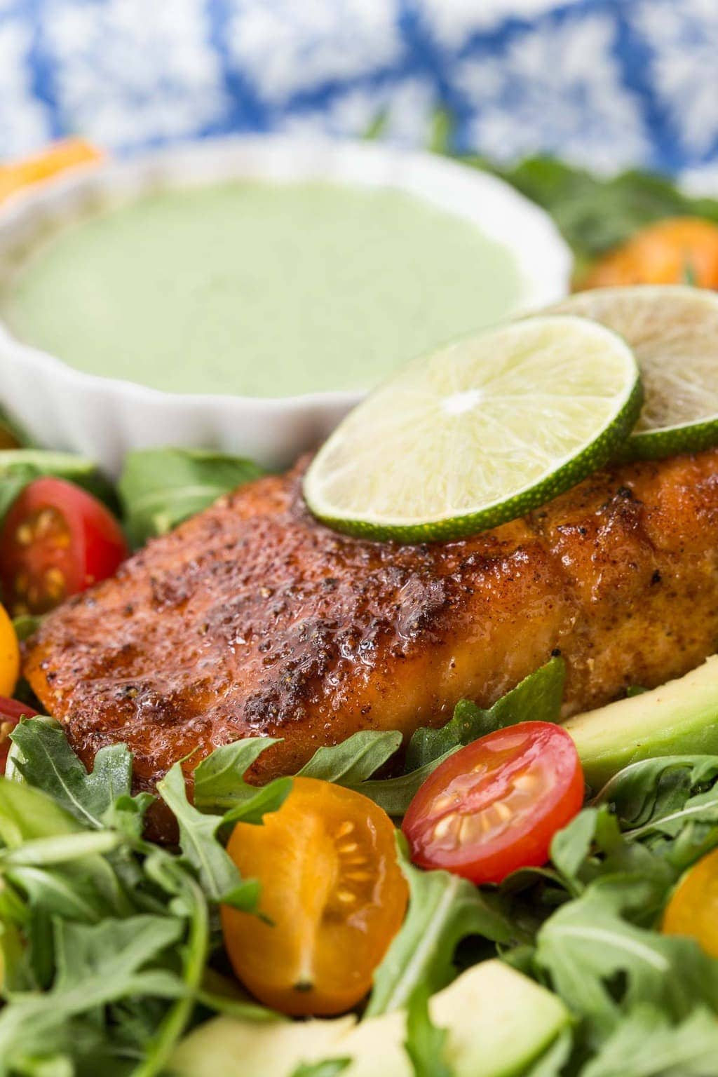 Vertical photo of Mexican Sugar Seared Salmon with dressing and salad.
