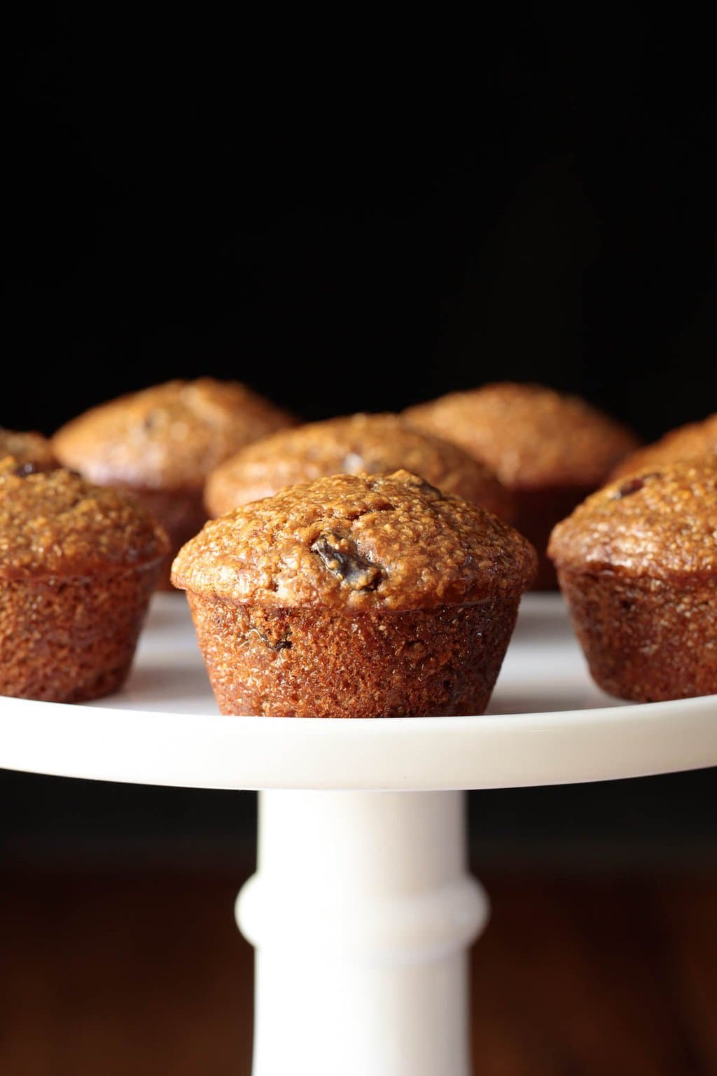 Closeup photo of a pedestal plate filled with One Bowl Buttermilk Bran Muffins.