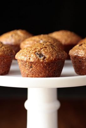 Vertical picture of Buttermilk Bran Muffins on a white cake stand