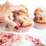 Vertical picture of strawberry buttermilk muffins on a white cake stand
