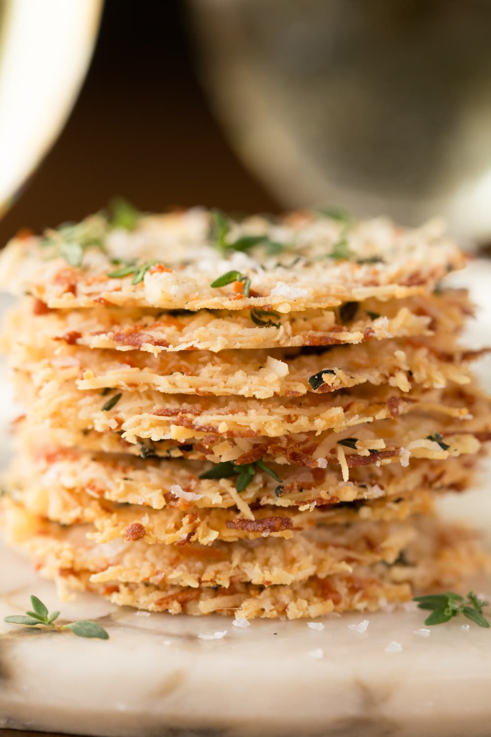 Parmesan Crisps with Thyme and Sea Salt - one of the most elegant (and easy!) Italian-inspired appetizers you'll ever have the pleasure of meeting. A delicious little bite to go with cocktails, on salads or as a soup topping. thecafesucrefarine.com