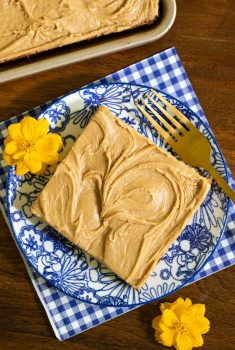 Overhead picture of Peanut Butter Texas Sheet Cake on a blue gingham napkin