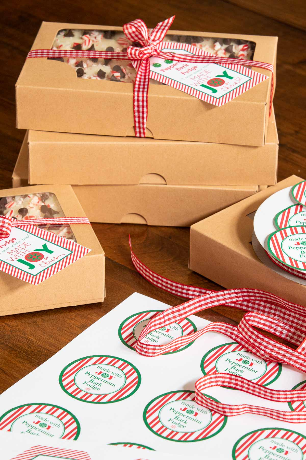 Vertical photo of boxes and gift labels for our Peppermint Bark Fudge recipe.