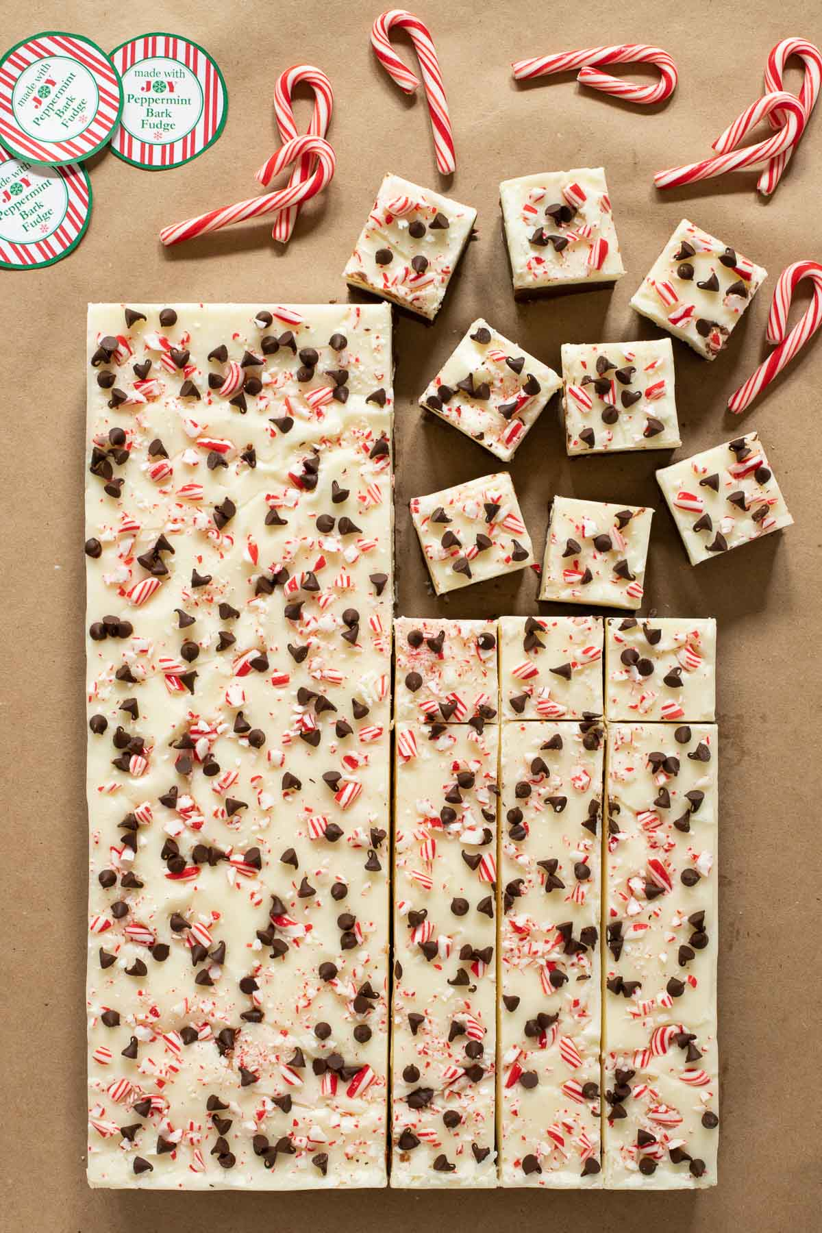 Overhead vertical photo of a slab of Peppermint Bark Fudge on parchment paper.