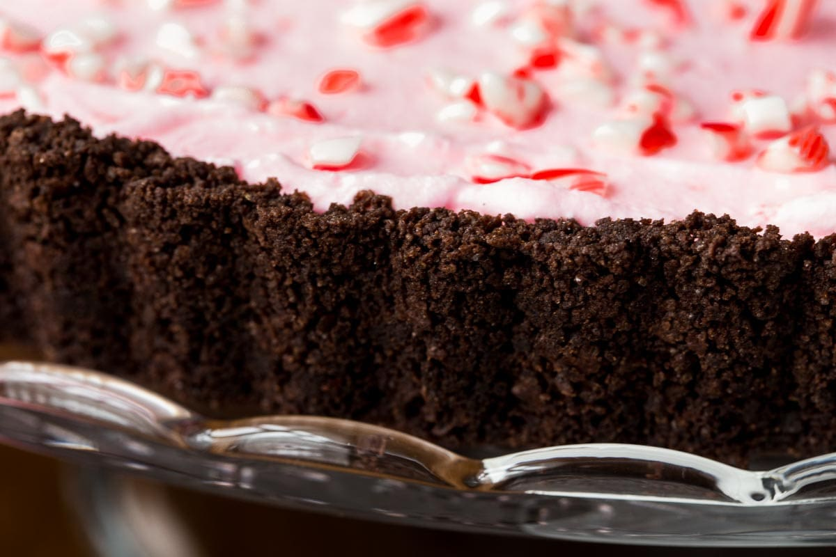 Closeup photo of the chocolate crust of a Peppermint Candy Cane Tart.