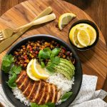 Overhead picture of Peruvian Chicken Rice Bowls on a wooden platter