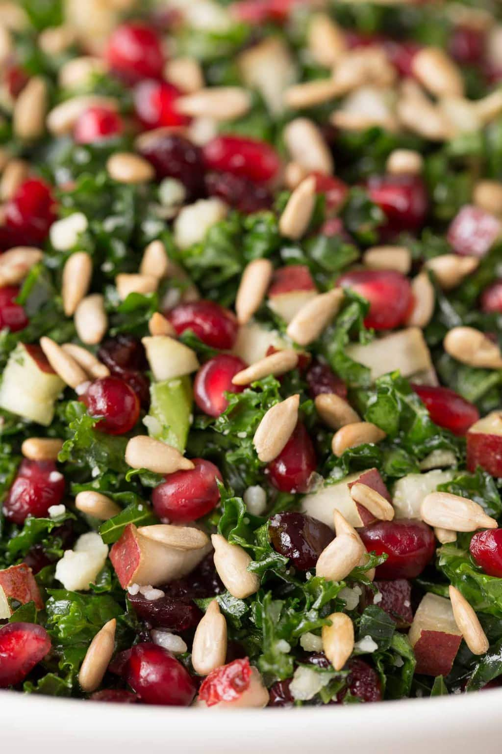 Ultra closeup of a Pomegranate Pear Kale Salad.