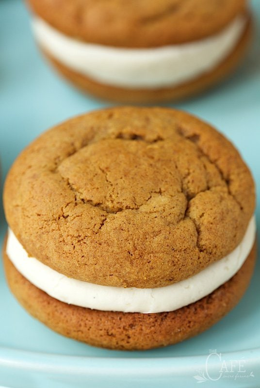 You won't even believe how fabulous these Pumpkin Whoopie Pies are! The cookies are soft, moist and loaded with warm fall spices; but the filling is what sends them over the top. It's the most magically delicious buttercream ever!! www.thecafesucrefarine.com