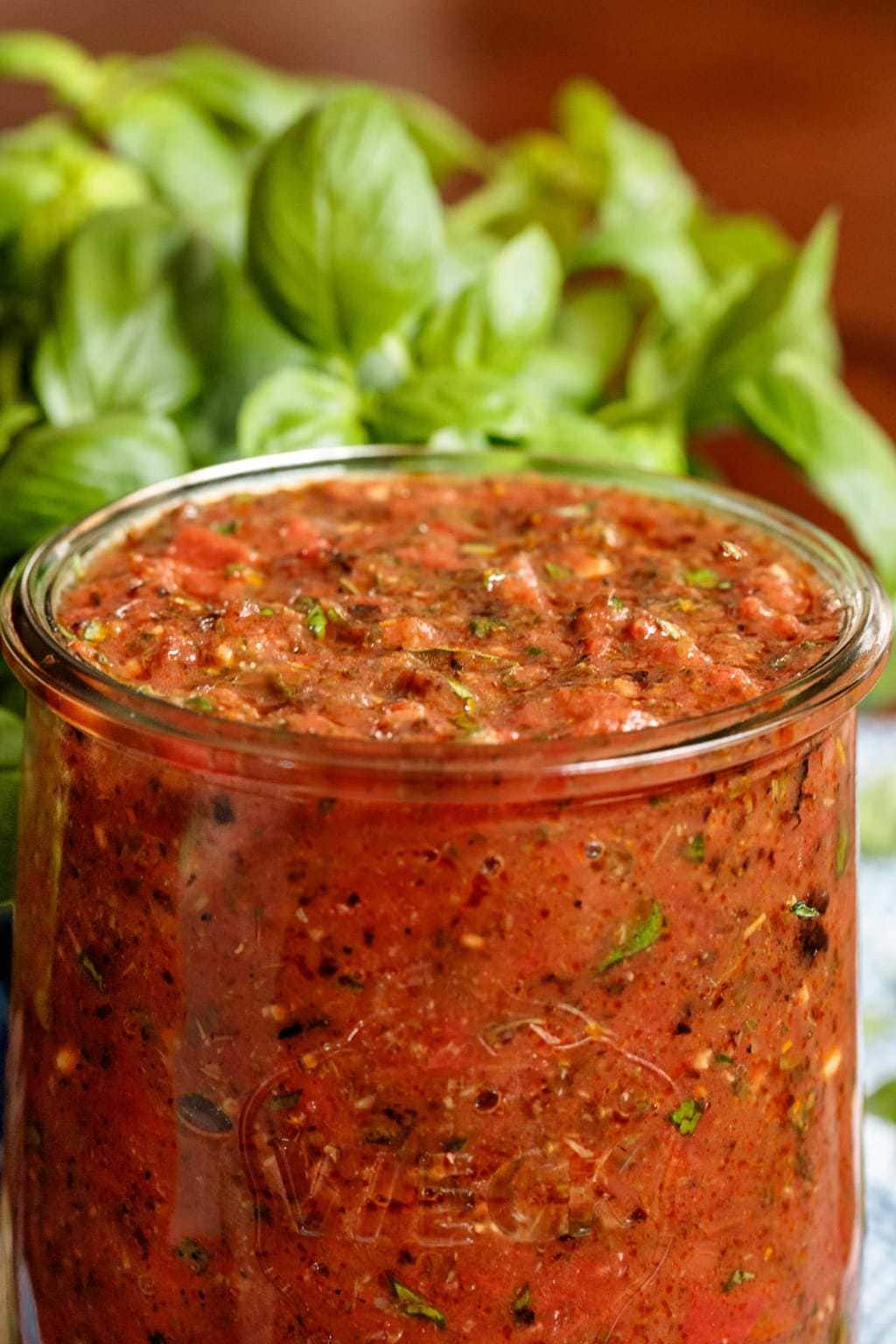 Photo of a Weck glass canning jar filled with Quick Easy Marinara Sauce.