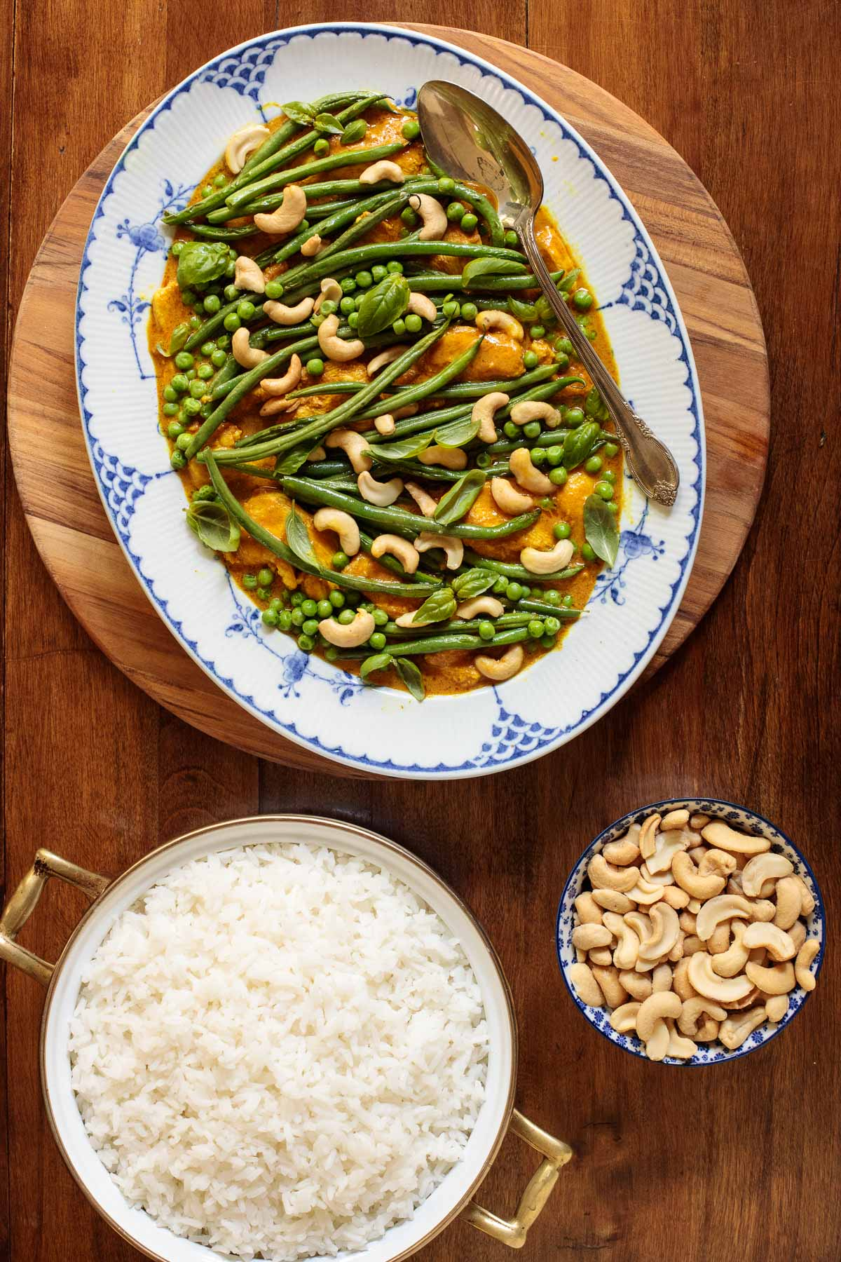 Overhead picture of easy coconut curry chicken with rice and cashews