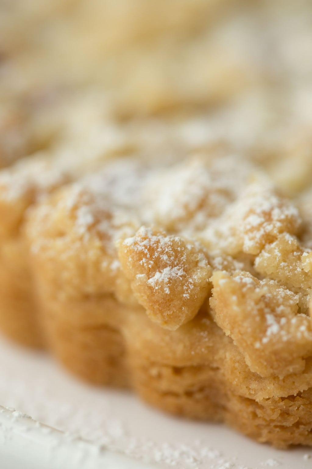 An ultra closeup of the side of a Raspberry Jam Shortbread Tart