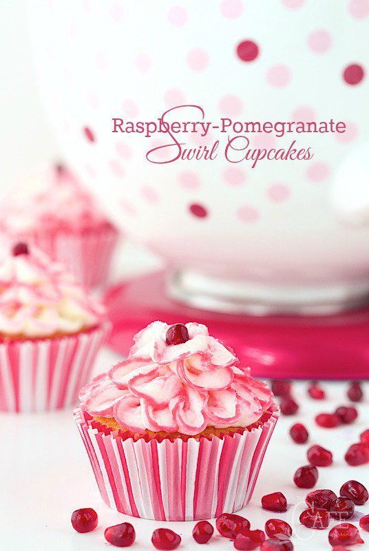 Raspberry Pomegranate Swirl Cupcakes - the most tender, melt-in-you-mouth cupcakes you'll ever meet. And there's a fun swirl of raspberry pomegranate syrup hidden inside!