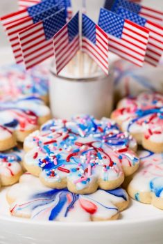 Vertical picture of glazed shortbread cookies and American flags
