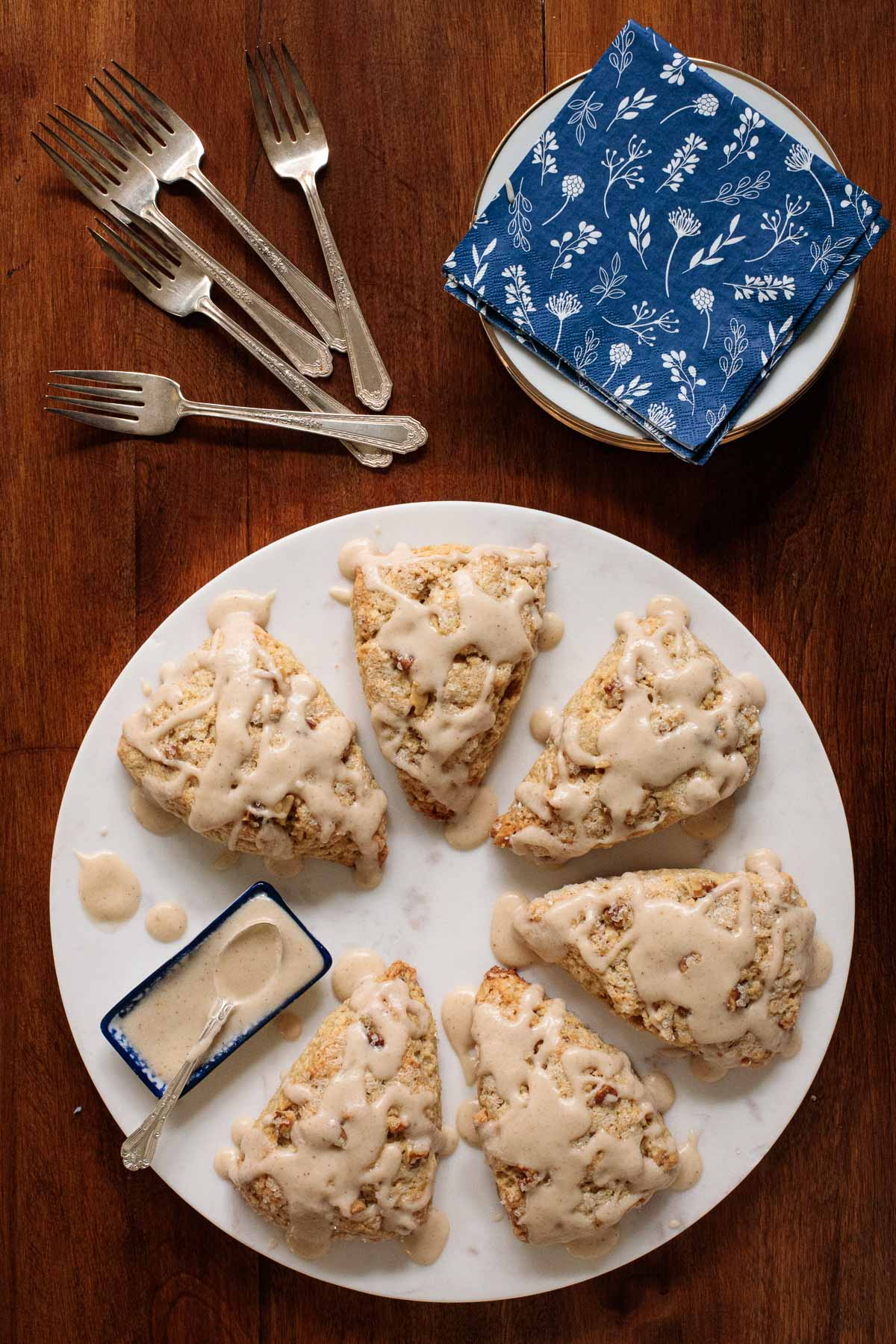 Overhead photo of a group of Ridiculously Easy Banana Bread Scones on a white platter.