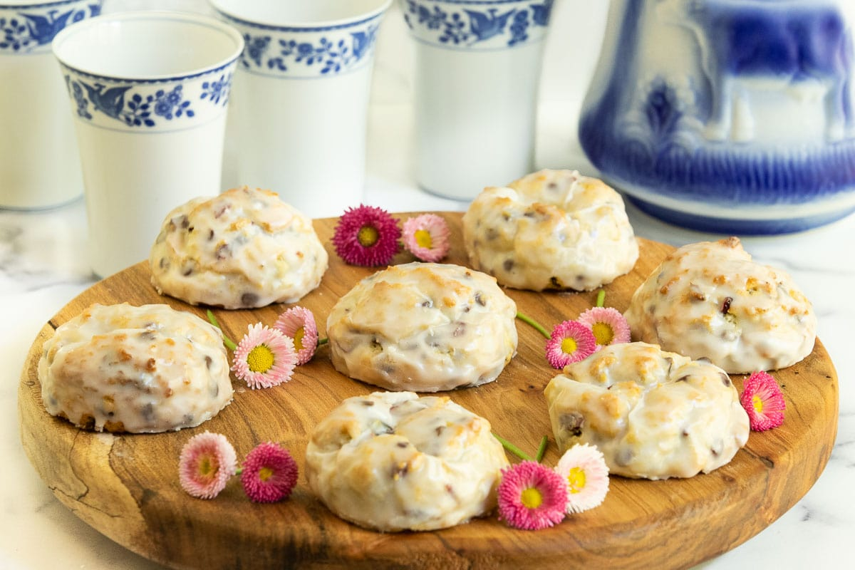 Horizontal photo of a batch of Ridiculously Easy Chocolate Chip Scones on a round wood serving platter.