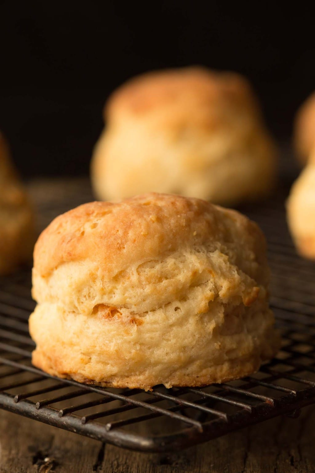 Side photo of a cooling rack full of Ridiculously Easy Buttermilk Biscuits.
