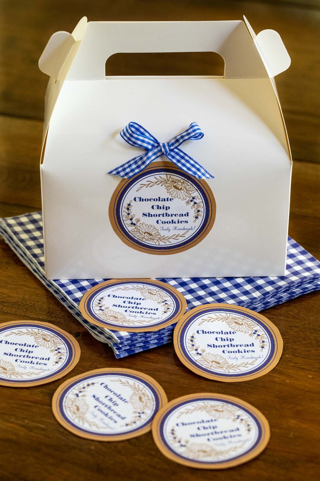 Vertical photo of custom Ridiculously Easy Chocolate Chip Shortbread gift boxes and custom labels.