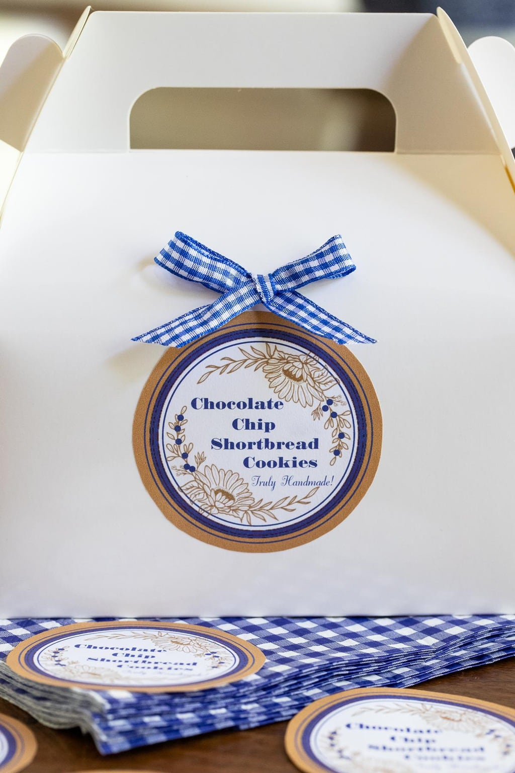 Vertical closeup photo of a white gift box with a custom Ridiculously Easy Chocolate Chip Shortbread label on the side.