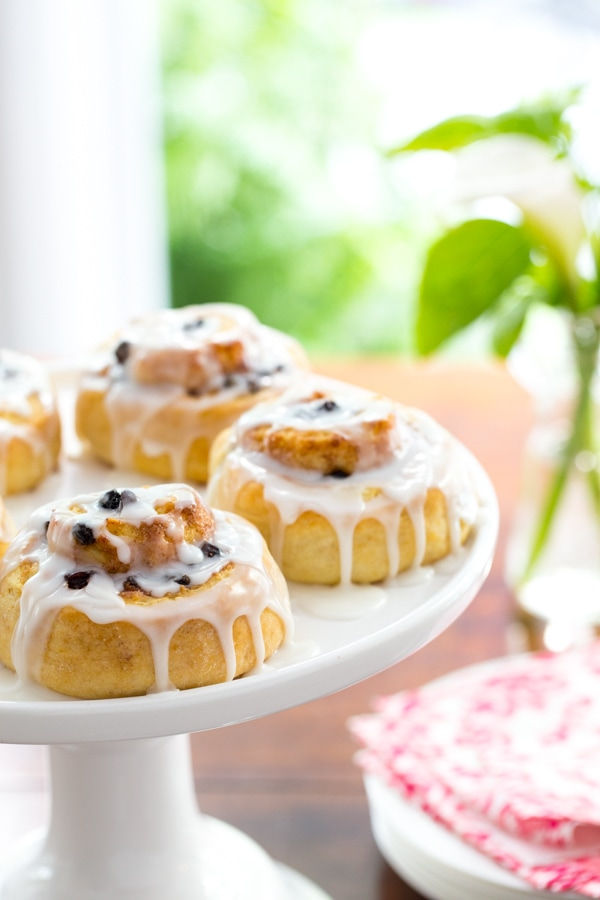 Photo of a cake stand filled with Ridiculously Easy Cinnamon Rolls.
