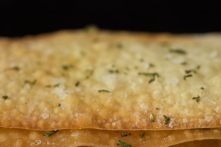 Closeup photo of the top of some Ridiculously Easy Olive Oil Rosemary Crackers.