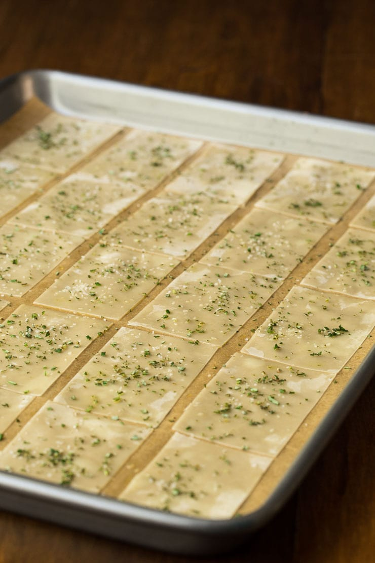 Prep photo of a baking pan of Ridiculously Easy Olive Oil Rosemary Crackers before they go into the oven.
