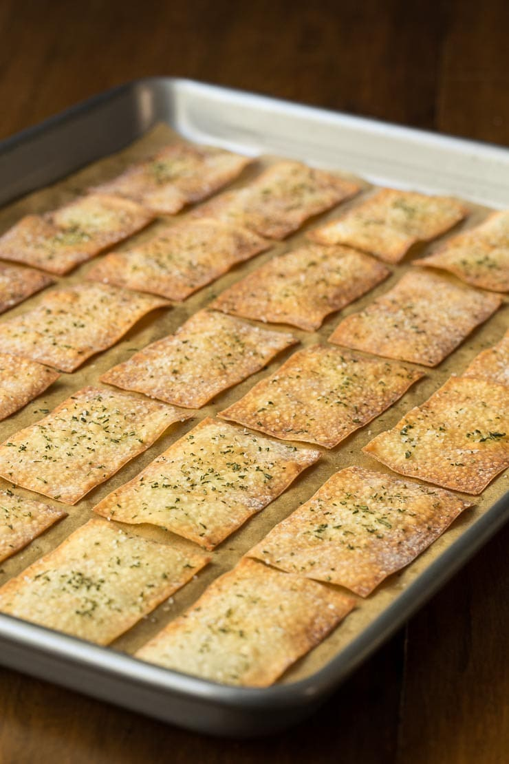 Prep photo of a baking pan of Ridiculously Easy Olive Oil Rosemary Crackers after they come out of the oven.