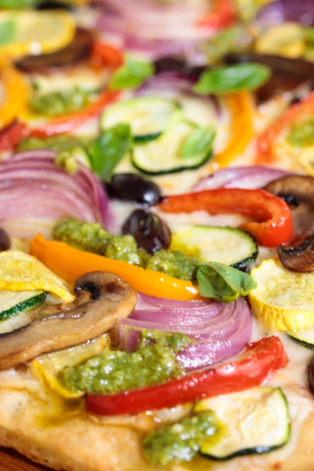 Side closeup photo of a Ridiculously Easy Roasted Veggie Pizza.