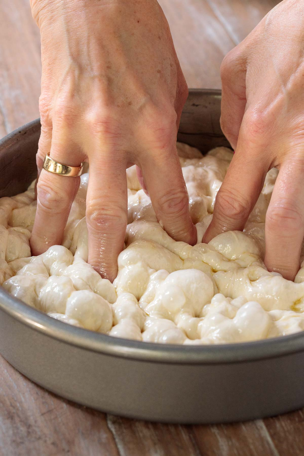 """Photo of how to create """"holes"""" in the Ridiculously Easy Focaccia Bread dough."""