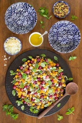 Overhead picture of Roasted Butternut Farro Salad on a wooden table