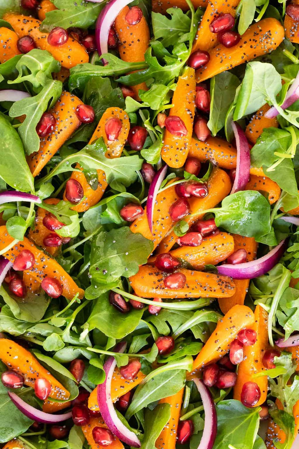Overhead vertical extreme closeup photo of a Roasted Carrot Salad with Cider Poppy Seed Dressing.