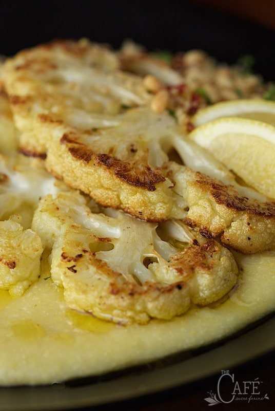Roasted Cauliflower Steaks with Parmesan Polenta and Lemon Parsley Panko Crumbs - These are so good you won't even miss the meat! thecafesucrefarine.com