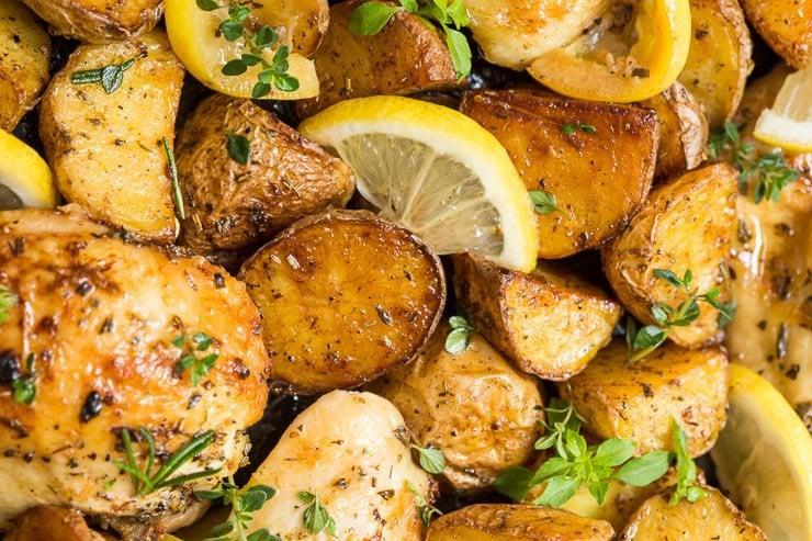 Closeup overhead photo of Lemon Garlic Roasted Chicken and Potatoes.