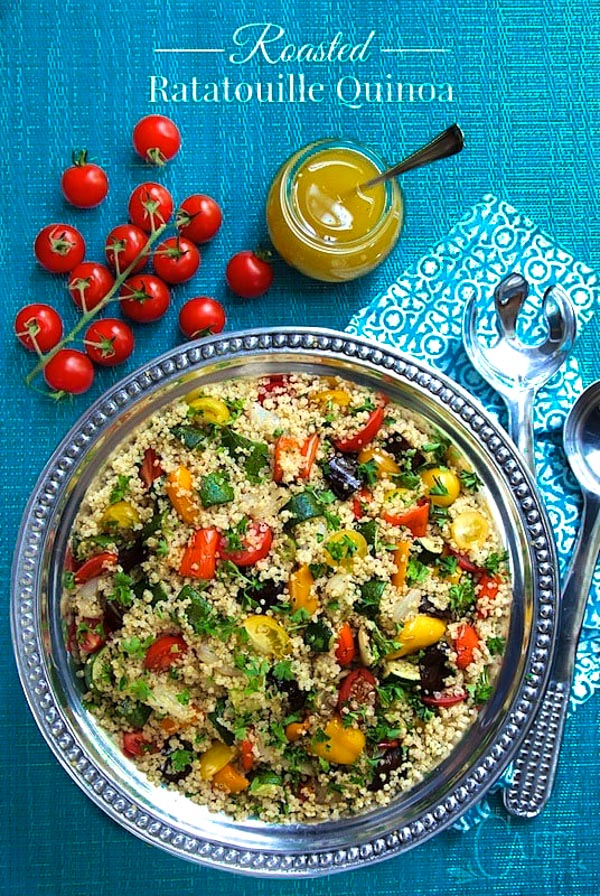 Overhead photo of Roasted Ratatouille Quinoa Salad on a silver platter with a deep blue background.