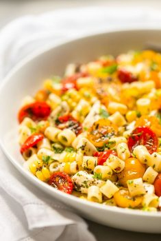 Close up vertical picture of Roasted Tomato Pasta in a white bowl