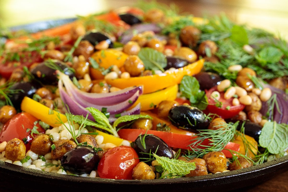 Side close up photo of a platter of Roasted Veggie and Crispy Chickpea Salad.