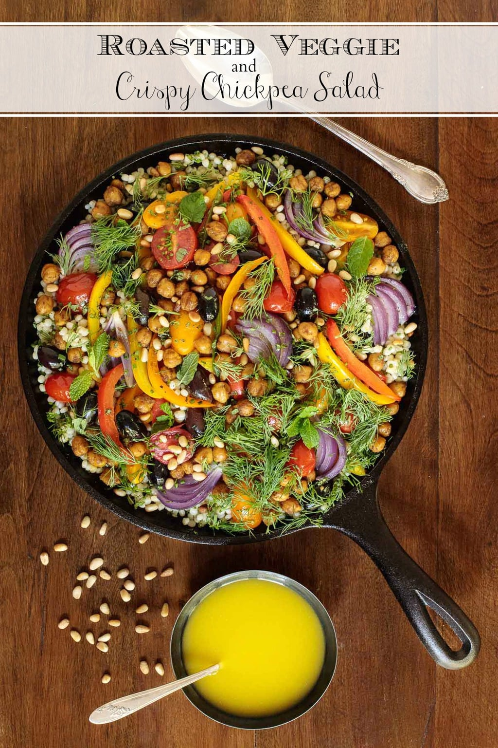 This healthy Roasted Veggie Chickpea Salad combines crispy, spiced chickpeas, caramelized veggies, Israeli couscous and lots of fresh herbs for a delicious side or main course! #roastedveggiesalad, #crispychickpeas, #fallsalad, #israelicouscoussalad